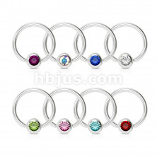 Piercing made of stainless steel – ring with a coloured crystal in a round bezel