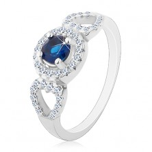 Ring made of 925 silver, round blue zircon, glossy heart contour on the sides