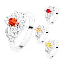 Ring in silver hue with smooth shiny arcs, coloured and clear zircons