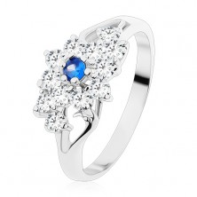 Ring with shiny split shoulders, clear flower with blue centre