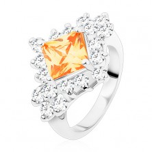 Ring in silver colour, light orange square zircon, round clear zircons