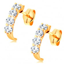 585 gold earrings - small sparkly arc composed of round clear zircons