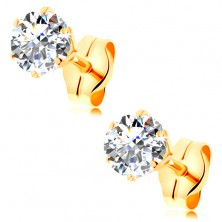 Earrings made of yellow 14K gold - clear round zircon in mount, 4 mm