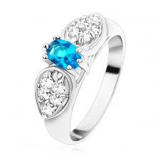 Shiny ring in silver colour, glossy bow with blue oval