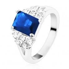 Ring in silver hue, dark blue zircon oblong, clear zircons