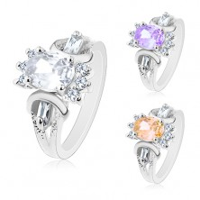 Ring in silver colour, cut coloured oval, round and oblong clear zircons