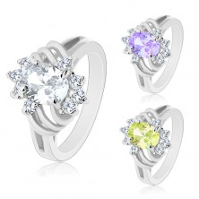 Ring in silver colour, cut coloured oval, thin arcs and clear zircons