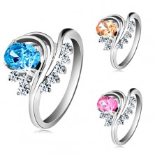 Ring in silver colour, bent lines, coloured oval zircon and clear zircons