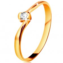 Ring made of yellow 14K gold - clear diamond between bent ends of shoulders