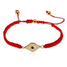 Adjustable red bracelet made of strings, symbol of eye decorated with clear zircons