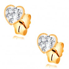 Stud earrings made of yellow 14K gold - heart inlaid with Swarovski crystals