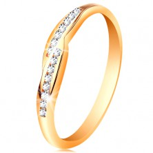 Ring made of yellow 14K gold, widened ends of shoulders with embedded zircons