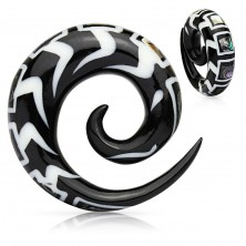 Spiral patterned ear expander made of organic material, fragments of shell