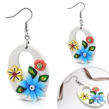 Dangling FIMO earrings, big white ovals with flowers and cutout, hooks