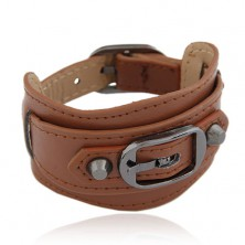 Brown wide bracelet made of synthetic leather, shiny black buckle and two rivets