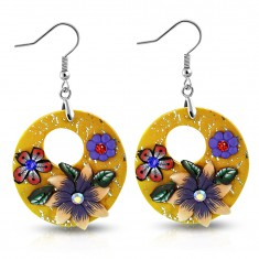 FIMO earrings, dangling orange circles with flowers and a round cut-out