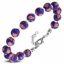 Purple bracelet, bigger FIMO balls with flowers and small transparent beads