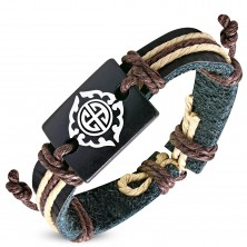 Black strip bracelet made of synthetic leather and brown strings, Tribal symbol