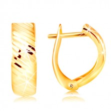 Earrings in 14K gold – arc with shiny diagonal cuts