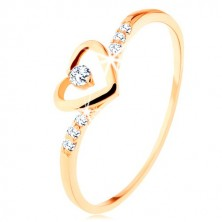 375 gold ring, heart-shaped contour with clear zircon, decorated shoulders