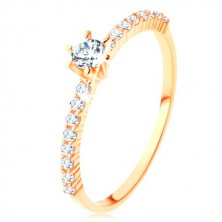 Ring made of yellow 9K gold - clear zircon lines, protruding round zircon