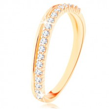 Ring made of yellow 9K gold - smooth and clear zircon wavy line